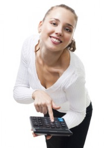 Young woman pointing on a calculator