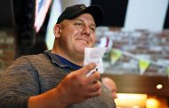 Tiger Woods bettor from Wisconsin cashes in on million-dollar tic...